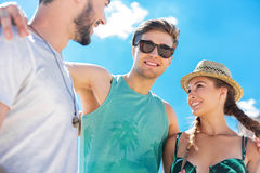 Cheerful attractive youthful friends having rest outdoor Stock Photo