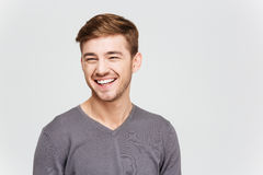 Cheerful attrative young man in grey pullover Royalty Free Stock Photo