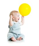 Cheerful baby with ballon in hand. Isolated on white Stock Images