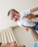 Cheerful baby being carried by father Royalty Free Stock Photography