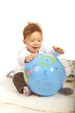 Cheerful baby with big world globe Stock Photo