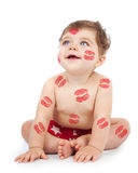 Cheerful baby boy. Photo of happy kid covered with red kisses print on the body, adorable baby boy sitting in studio isolated on white background, nice toddler Stock Photos