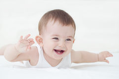 Cheerful baby boy Stock Images