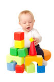 Cheerful baby boy playing with colorful blocks Royalty Free Stock Photography