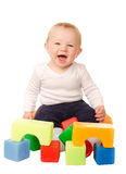 Cheerful baby boy playing with colorful blocks Stock Photography