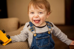 Cheerful baby boy playing with toys Royalty Free Stock Image