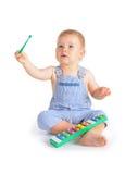 Cheerful baby boy and xylophone Stock Image