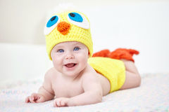 Cheerful baby in chicken hat Royalty Free Stock Photos