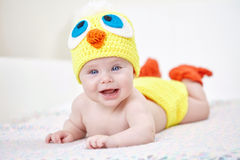 Cheerful baby in chicken hat Royalty Free Stock Photography