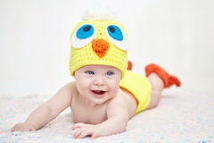 Cheerful baby in chicken hat Royalty Free Stock Image