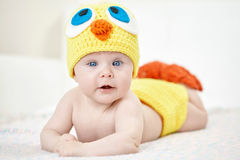 Cheerful baby in chicken hat Royalty Free Stock Images