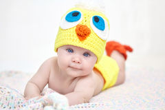 Cheerful baby in chicken hat Stock Photos