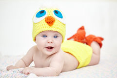 Cheerful baby in chicken hat Stock Image