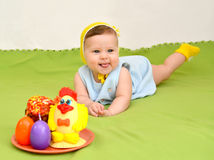 The cheerful baby with an easter entertainment Stock Photo