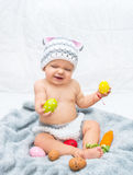 Cheerful baby girl in bunny hat gray blanket Stock Photography