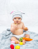 Cheerful baby girl in bunny hat gray blanket Royalty Free Stock Photography
