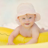 Cheerful  baby girl with Downs Syndrome playing in the pool Stock Photo