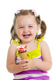 Cheerful baby girl eating ice-cream isolated Royalty Free Stock Photography