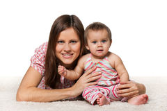 Cheerful baby girl with smiling mother Stock Photo