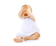 Cheerful baby. Having fun on a white Royalty Free Stock Photo