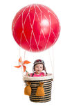 Cheerful baby on hot air balloon Stock Image
