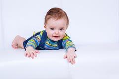 Cheerful baby lying Stock Image