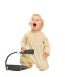 Cheerful baby with phone looking up Royalty Free Stock Images