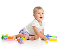 Cheerful baby playing with construction set Royalty Free Stock Photography