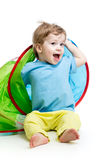 Cheerful baby playing in a tent Royalty Free Stock Image