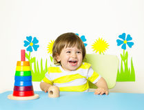 Cheerful baby playing with toy Stock Image