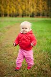 Cheerful baby walk on grass road in park Stock Photo