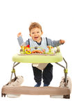 Cheerful baby in a walker Royalty Free Stock Image