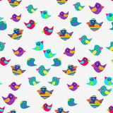 Cheerful background of colorful birds on a white background. Royalty Free Stock Photography