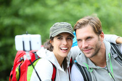 Cheerful backpackers taking selfie in forest Stock Images