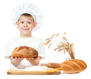 Cheerful baker boy with a loaf of rye bread Stock Image