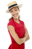Cheerful baker woman wearing straw bowler hat Stock Image