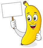 Cheerful Banana Holding a Blank Banner Royalty Free Stock Image
