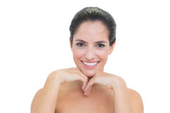 Cheerful bare brunette touching her chin Royalty Free Stock Image