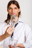Cheerful barman filling glasses. Royalty Free Stock Photos