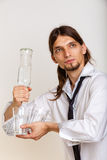 Cheerful barman filling glasses. Royalty Free Stock Image