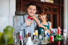 Cheerful barman and waitress Royalty Free Stock Image