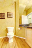 Cheerful bathroom interior in bright yellow color. Stock Photography