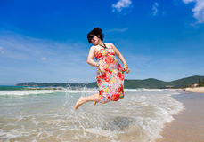 Cheerful beach jump Stock Photo