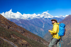Cheerful bearded Hiker standing and looking up Royalty Free Stock Image