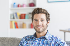 Cheerful bearded hipster man in white modern house. Face camera Stock Photo