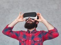 Cheerful bearded man adjusting VR helmet Royalty Free Stock Images