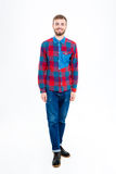 Cheerful bearded young male in checkered shirt and jeans Stock Photography