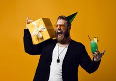 Cheerful bearded young man holding cocktail and smile to camera isolated royalty free stock photo