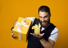 Cheerful bearded young man holding cocktail and smile to camera isolated stock photography