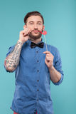 Cheerful bearded young man is making fun Royalty Free Stock Photos